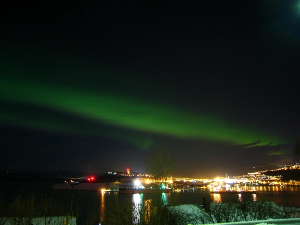 Northern Lights Above the City and the clouds to the right in the picture