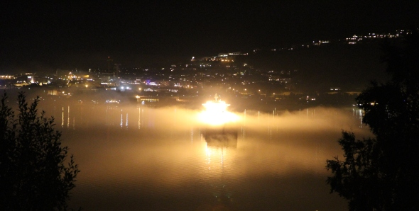 Bulk Carrier ablaze - not she isn't - her deck lighst are just cover with the dim fog
