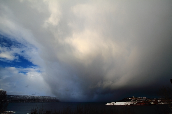 A shower of snow moving through the Ofoten Fjord