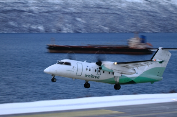 Take off from Narvik - in the background an iron ore carrier waiting to get to port