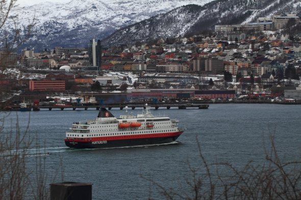 "Steaming to port: Hurtigruten ship ""Richard With"". In the background - tall building - the brand new Rica Hotel, a competitor to the hotel and restaurant service provided by ""Richard With"". Op to the right, the polytechnical college in Narvik."