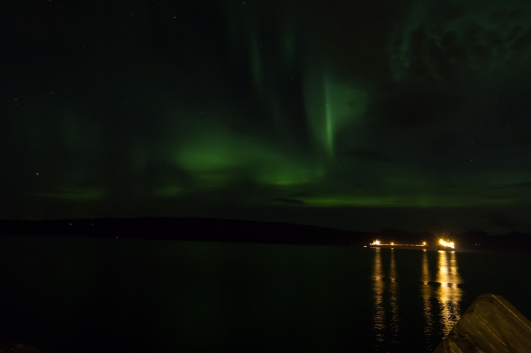Tonights Northern Lights (Aurora Borealis) reflected in the Ofoten Fjord with a couple of iron ore bulk carriers at anchor waiting for service.