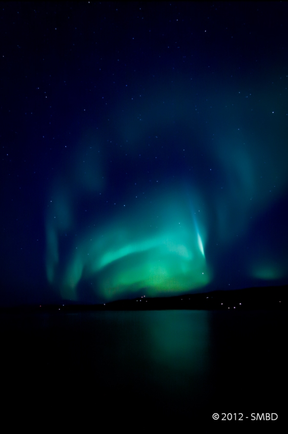 Northern Lights lighting up The Ofoten Fjord with the mountain range Veggen in the background. October 12. 2012