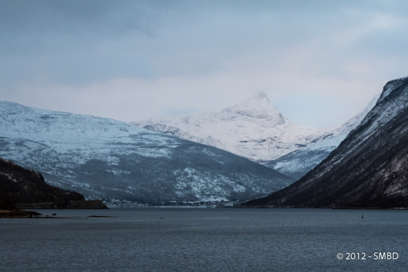 Beisfjord and the mountain Beisfjordtøtta farthest away in between the snow showers