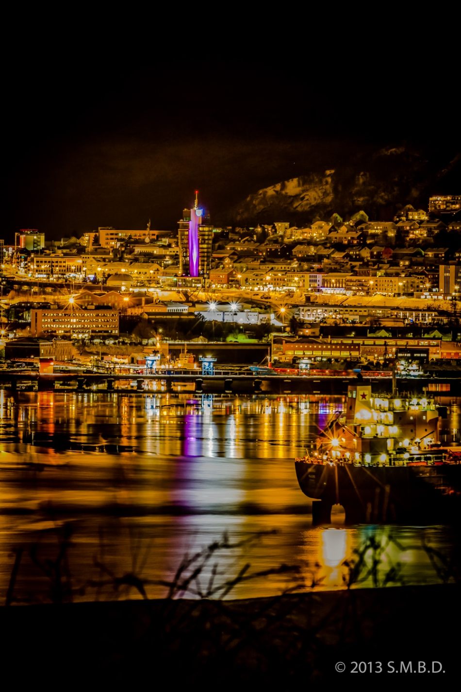 Sleepless in Narvik - The newly installed lightshow on the new hotell downtown reflects in the harbor bassin.
