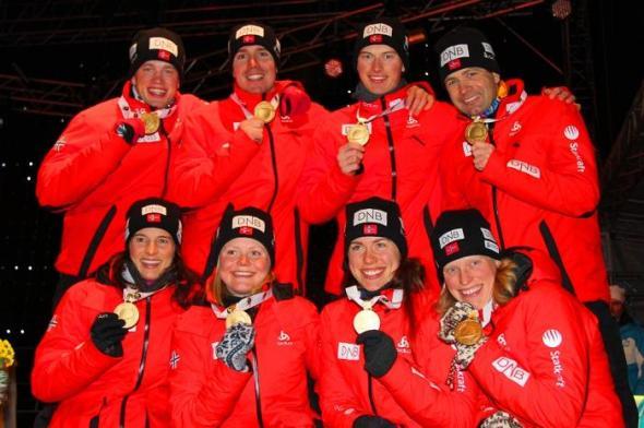 "Norwegian World Championship Gold Medalists: (back from the left) Tarjei Boe (Bø), Emil Hegle Svendsen, Henrik L'Abée-Lund and the ""King of Biathlon"" Ole Einar Bjoerndalen (Bjørndalen)  (Front from left to right) Ann Kristin Aafedt Flatland, Hilde Fenne, Synnoeve (Synnøve) Solemdal and the ""Queen of Biathlon"" Tora Berger."